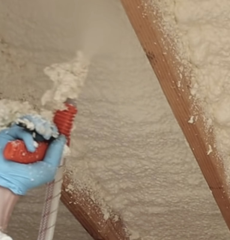 spraying closed cell foam insulation in attic