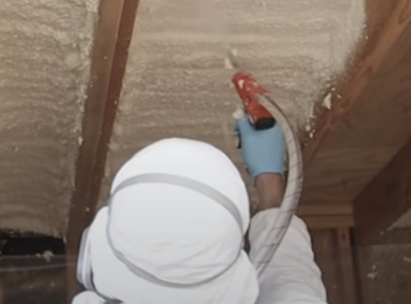 contractor spraying insulation